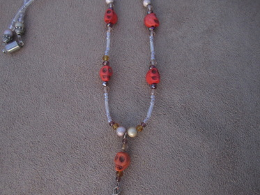 skull necklace orange howlite dangle necklace