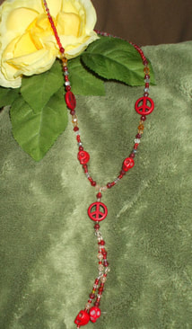 skull necklace handcrafted red howlite skull and peace sign necklace peace and quiet